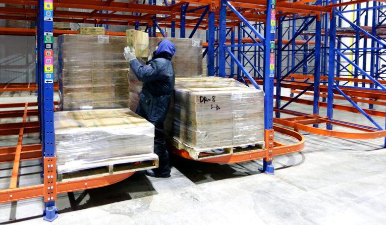 Warehouse worker picking a case from Frazier's Ergo Deep.