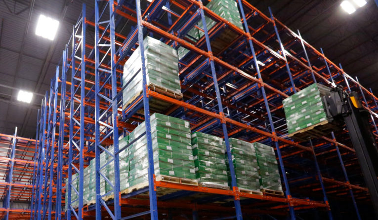 Frazier's five-deep Glide-In® Push Back racking sotres pallets of meat products in Thomas Foods International USA's refrigerated warehouse.