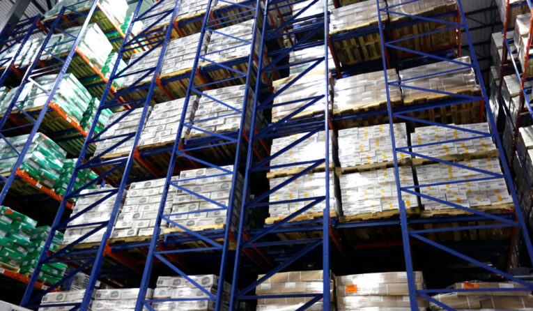Two back to back rows of Glide-In® Push Back rack store pallets 3 positions deep.